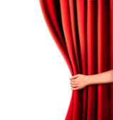 Background with red velvet curtain and hand. Vector illustration. — Stockvector
