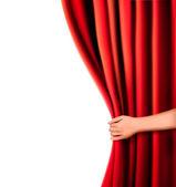 Sfondo con tenda di velluto rosso e mano. illustrazione vettoriale. — Vettoriale Stock