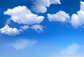 Blauwe hemel met wolken. vector achtergrond — Stockvector