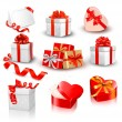 Set of colorful vector gift boxes with bows and ribbons. — Vecteur #13749506