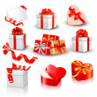 Set of colorful vector gift boxes with bows and ribbons. — Vecteur