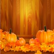 Pumpkins on wooden background with leaves. Autumn background. Vector. — Stock Vector