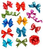 Stor uppsättning färgglada gåva bågar med band. vektor illustration. — Stockvektor
