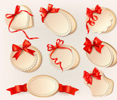 Set of beautiful retro labels with red gift bows with ribbons. Vector illustration. — Stock Vector