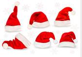红色圣诞老人的帽子的大集合。矢量. — 图库矢量图片