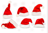 Big collection of red santa hats. Vector. — Vecteur