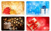 Collectie van kerst achtergronden met geschenkdozen en sneeuwvlokken. vectorillustratie. — Stockvector