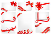 Set of beautiful cards with red gift bows with ribbons — Stock Vector