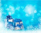 Jul blå bakgrund med presentask och snöflinga. — Stockvektor