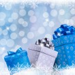 Christmas blue background with gift boxes and snowflakes. Vector — Stock Vector #15556887