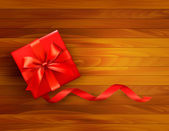 ホリデー ギフト用の箱と赤の弓と背景。illustratio をベクトルします。 — ストックベクタ