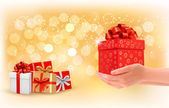 Christmas background with gift boxes. Concept of giving presents — Stock vektor