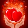 Valentine`s day background. Hands holding two red hearts. Vector — Stok Vektör