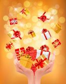 Holiday background with hands holding gift boxes. Concept of giv — Stock Vector