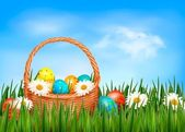 Easter background. Easter eggs and flower with basket in the gra — Stock Vector
