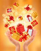 Fond de vacances avec des mains tenant des coffrets cadeaux. concept de giv — Vecteur