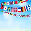 World bunting flags on blue sky. Vector illustration — Stock Vector