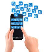Manos sosteniendo el teléfono móvil con iconos. vector. — Vector de stock