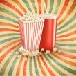Retro background with Popcorn and a drink. Vector illustration. — Stock Vector