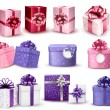 Stock Vector: Set of colorful gift boxes with bows and ribbons. Vector illustr