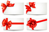 Set of beautiful gift cards with red gift bows with ribbons Vect — Stock Vector