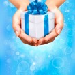 Holiday background with hands holding gift boxes. Concept of giving presents. — 图库矢量图片