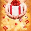Holiday background with hands holding gift boxes. Concept of giv — Vektorgrafik