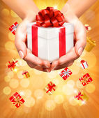 Holiday background with hands holding gift boxes. Concept of giv — Vetor de Stock