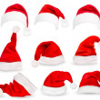 Collection of red santa hats. Vector.  — Imagen vectorial
