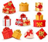 Sistema de cajas de regalo colorido con arcos y cintas. vector — Vector de stock