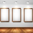 Empty wooden frames on wall with spotlights and wooden floor. Ve — Stock Vector
