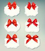 Set of beautiful retro labels with red gift bows with ribbons. V — Stock Vector