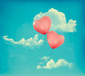 Valentine heart-shaped baloons in a blue sky with clouds. Vector — Stock Vector