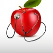Stethoscope and red apple. Medical background. Vector — Stock Vector #42375949
