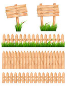 Set of wooden signs and a fences with grass. Vector. — Stock Vector