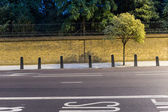 Bus lane and empty road — Stock Photo