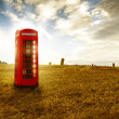Traditional red telephone booth — Stock Photo #12571071