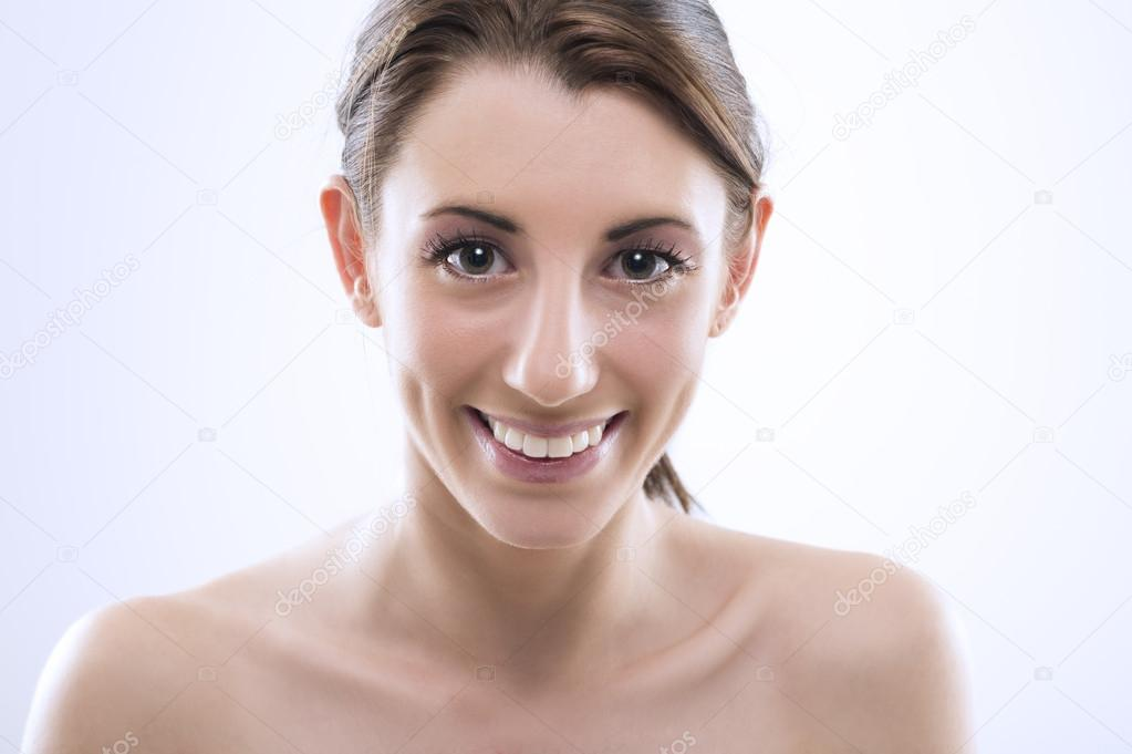 Fresh clean portrait of a beautiful smiling young woman with large lustrous eyes and her long brunette hair tied neatly in a ponytail , studio head and shoulers port — Stock Photo #14083921