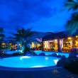 Night pool side of rich hotel — Stock Photo #13129681