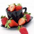 Fresh and ripen strawberry in black cup — Stock Photo #13195926
