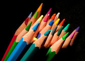 Top view of colored pencils, isolated on a black background — Stock Photo
