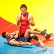 BUCHAREST, ROMANIA - JULY 25: Unidentified wrestlers fight durin — 图库照片