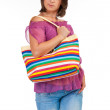 Beautiful woman holding beach bag — Stock Photo