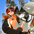 Young girl holding snowboard in wood — Stok Fotoğraf #13705605
