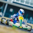 Unknown pilot competing in National Karting Championship - Stock Photo