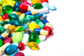 Colorful tablets with capsules — Stock Photo