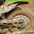 Stock Photo: Detail view to the wheel of motocross bike.