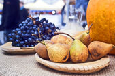 Pears and grapes on rustic wooden table — Stock Photo