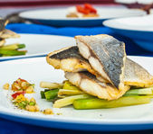 Grilled fish with vegetables — Stock Photo