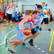 Постер, плакат: Bascketball players perform during the game Sport Arena Streetball 3x3